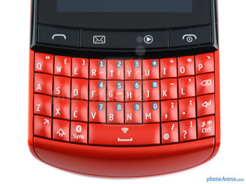 The four-row physical QWERTY is slightly curved - Nokia Asha 303 Review