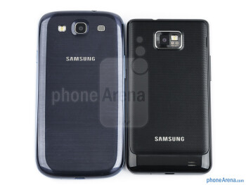 Backs - The sides of the Samsung Galaxy S III (bottom, left) and the Samsung Galaxy S II (top, right) - Samsung Galaxy S III vs Samsung Galaxy S II