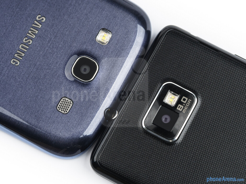 Rear cameras - The sides of the Samsung Galaxy S III (bottom, left) and the Samsung Galaxy S II (top, right) - Samsung Galaxy S III vs Samsung Galaxy S II