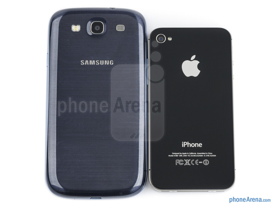 Backs - The sides of the Samsung Galaxy S III (bottom, left) and the Apple iPhone 4S (top, right) - Samsung Galaxy S III vs Apple iPhone 4S