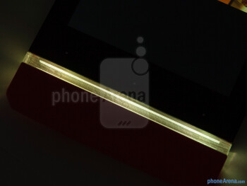 "The illuminated transparent strip at the bottom lights up when you press the three capacitive ""dots"" above it - Sony Xperia U Review"