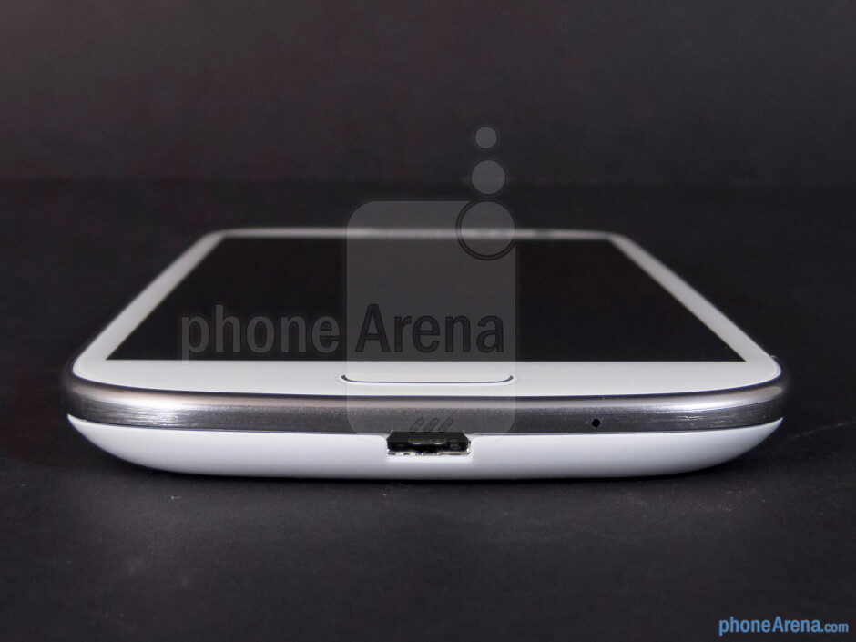 microUSB port (bottom) - The sides of the Samsung Galaxy S III - Samsung Galaxy S III Review (AT&T, Verizon, T-Mobile, Sprint)