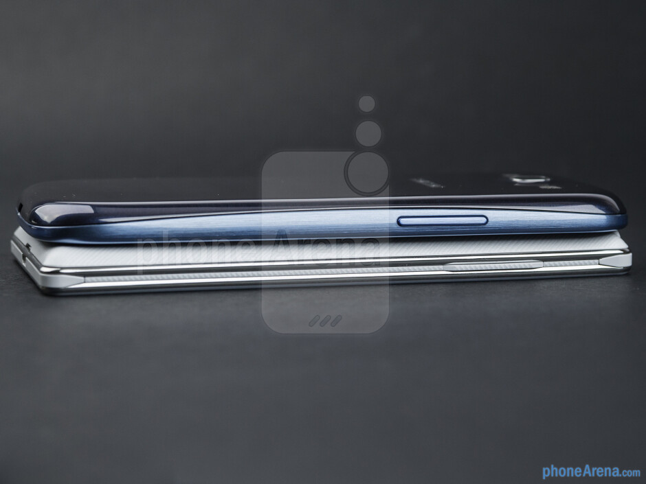 Left sides - The LG Optimus 4X HD (bottom) and the Samsung Galaxy S III (top) - LG Optimus 4X HD vs Samsung Galaxy S III