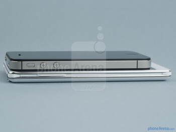The sides of the LG Optimus 4X HD (bottom) and the Apple iPhone 4S (top) - LG Optimus 4X HD vs Apple iPhone 4S