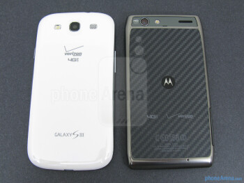 The backs of the Samsung Galaxy S III (left) and the Motorola DROID RAZR MAXX (right) - Samsung Galaxy S III vs Motorola DROID RAZR MAXX