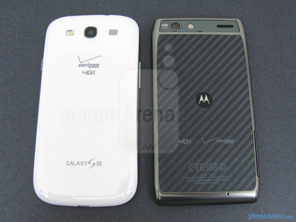 The backs of the Samsung Galaxy S III (left) and the Motorola DROID RAZR MAXX (right) - Samsung Galaxy S III vs Motorola DROID RAZR MAXX