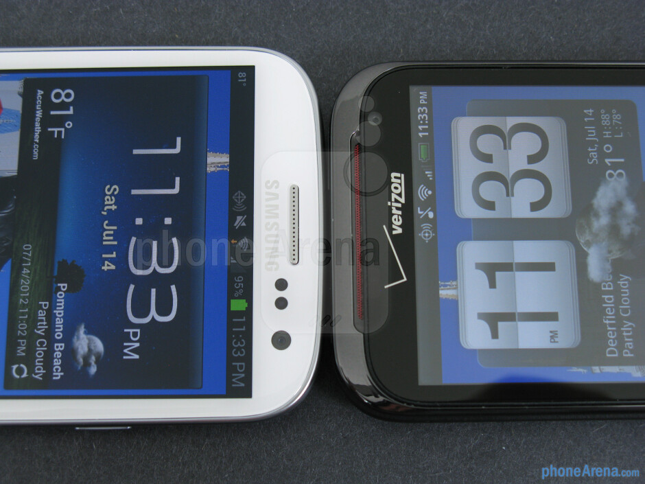 The sides of the Samsung Galaxy S III (left, bottom) and the HTC Rezound (right, top) - Samsung Galaxy S III vs HTC Rezound