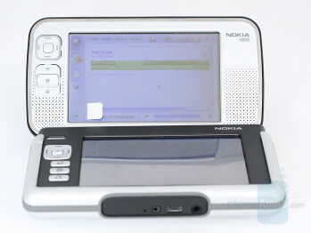 N800 next to Nokia 770 with protective lid - N800 on the table - Nokia N800 Internet Tablet Review