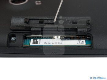 microSD and SIM card slots - The sides of the Sony Xperia T - Sony Xperia T Review