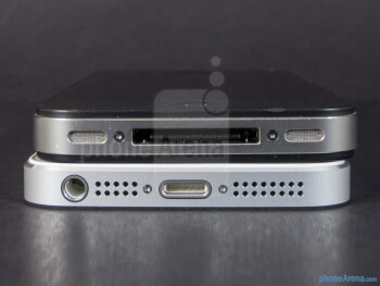 Bottom sides - The Apple iPhone 5 (bottom, left) and the Apple iPhone 4S (top, right) - Apple iPhone 5 vs Apple iPhone 4S
