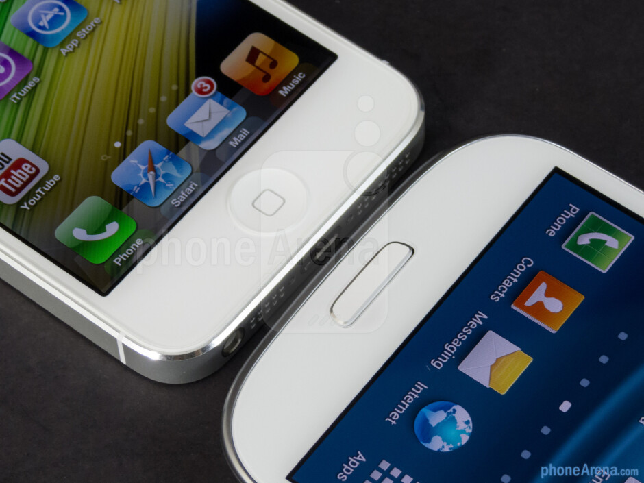 Buttons below the displays - The Apple iPhone 5 (left) and the Samsung Galaxy S III (right) - Apple iPhone 5 vs Samsung Galaxy S III