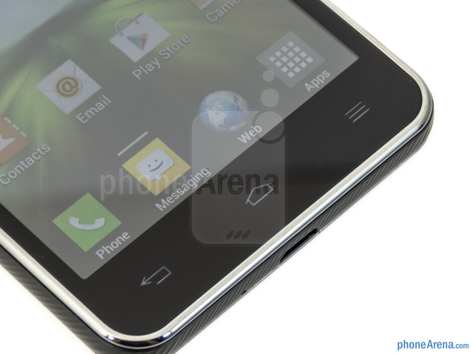 The capacitive buttons are below the display, while the 1.3-megapixel camera is above it - LG Escape Review