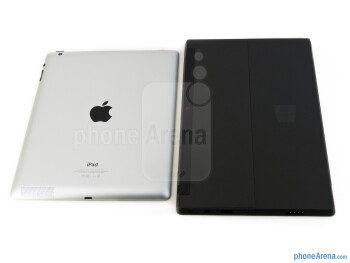 The sides of the Apple iPad 4 (top, left) and the Microsoft Surface RT (bottom, right) - Apple iPad 4 vs Microsoft Surface RT
