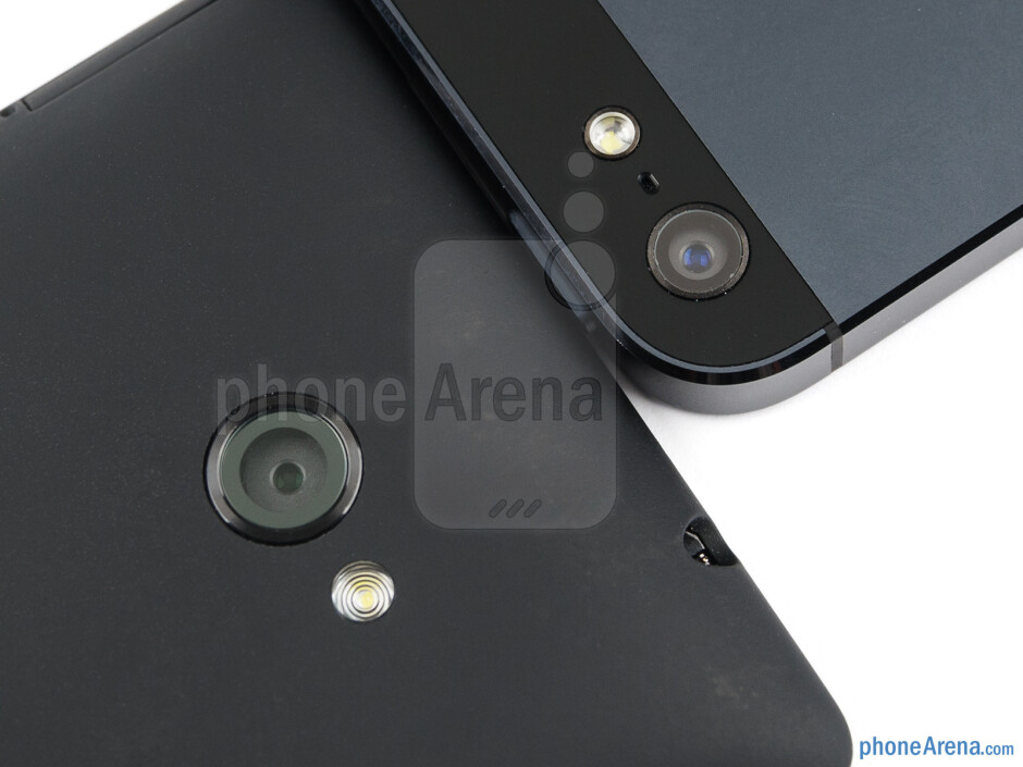 Rear cameras - The HTC Windows Phone 8X (bottom, left) and the Apple iPhone 5 (top, right) - HTC Windows Phone 8X vs Apple iPhone 5