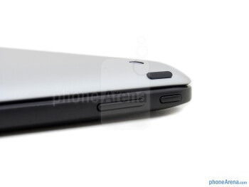 Power keys - The Google Nexus 10 (bottom, left) and the Apple iPad 4 (top, right) - Google Nexus 10 vs Apple iPad 4