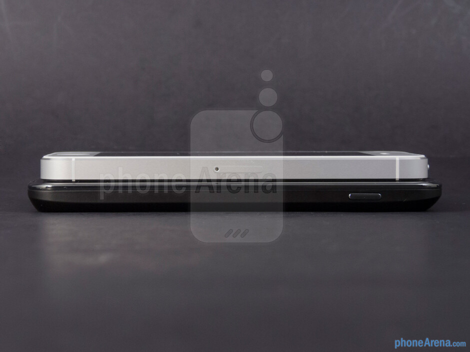 Right edges - The sides of the Google Nexus 4 (bottom) and the Apple iPhone 5 (top) - Google Nexus 4 vs Apple iPhone 5