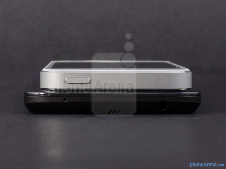 The sides of the Google Nexus 4 (bottom) and the Apple iPhone 5 (top) - Google Nexus 4 vs Apple iPhone 5
