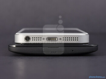 Bottom edges - The sides of the HTC DROID DNA (bottom, left) and the Apple iPhone 5 (top, right) - HTC DROID DNA vs Apple iPhone 5