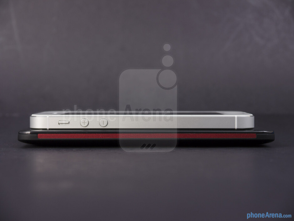 Left - The sides of the HTC DROID DNA (bottom, left) and the Apple iPhone 5 (top, right) - HTC DROID DNA vs Apple iPhone 5