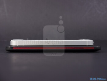 Right - The sides of the HTC DROID DNA (bottom, left) and the Apple iPhone 5 (top, right) - HTC DROID DNA vs Apple iPhone 5