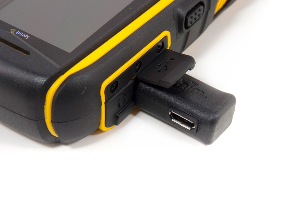 microUSB adapter - Battery compartmentThe sides of the Sonim XP Strike - Sonim XP Strike Review