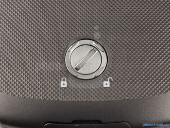 The back cover is secured in place with a circular screw - Samsung Galaxy Xcover 2 Review