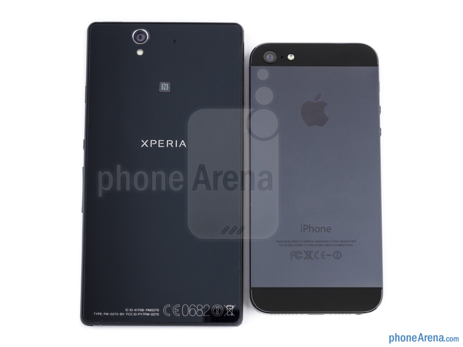 Backs - The sides of the Sony Xperia Z (bottom, left) and the Apple iPhone 5 (top, right) - Sony Xperia Z vs Apple iPhone 5
