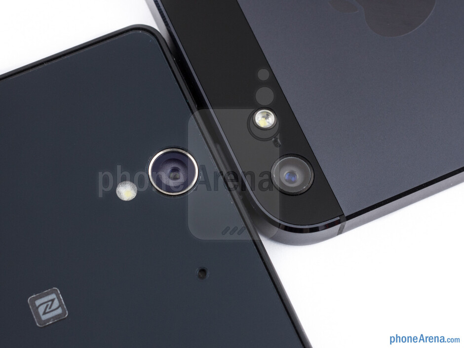 Rear cameras - The sides of the Sony Xperia Z (bottom, left) and the Apple iPhone 5 (top, right) - Sony Xperia Z vs Apple iPhone 5