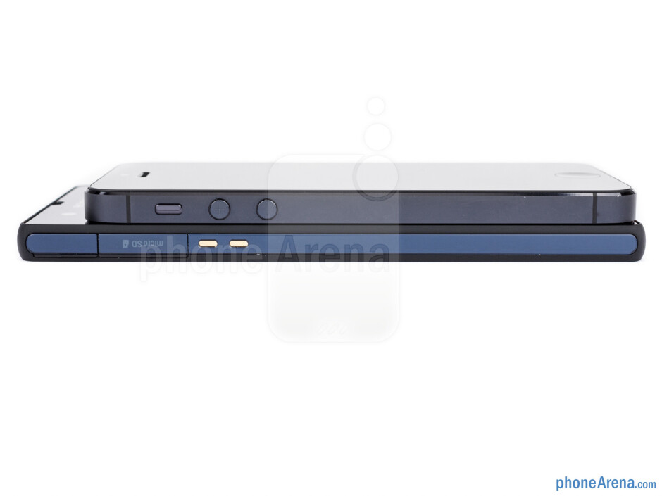 Left sides - The sides of the Sony Xperia Z (bottom, left) and the Apple iPhone 5 (top, right) - Sony Xperia Z vs Apple iPhone 5