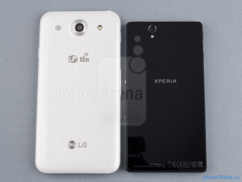 Backs - The sides of the LG Optimus G Pro (bottom, left) and the Sony Xperia Z (top, right) - LG Optimus G Pro vs Sony Xperia Z