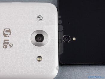 Rear cameras - The sides of the LG Optimus G Pro (bottom, left) and the Sony Xperia Z (top, right) - LG Optimus G Pro vs Sony Xperia Z