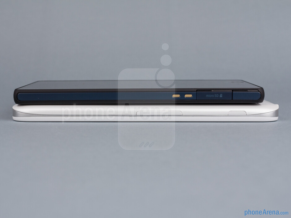 Left sides - The sides of the LG Optimus G Pro (bottom, left) and the Sony Xperia Z (top, right) - LG Optimus G Pro vs Sony Xperia Z