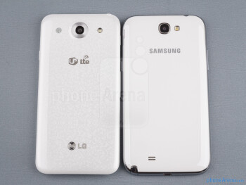 Backs - The sides of the LG Optimus G Pro (bottom, left) and the Samsung Galaxy Note II (top, right) - LG Optimus G Pro vs Samsung Galaxy Note II