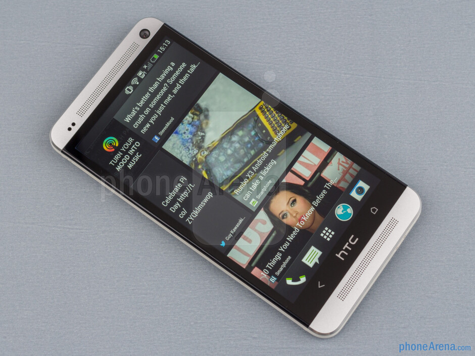 The front comes with two large speaker grills and a new button layout - HTC One Review