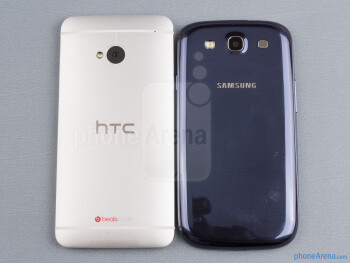 Backs - The sides of the HTC One (bottom, left) and the Samsung Galaxy S III (top, right) - HTC One vs Samsung Galaxy S III
