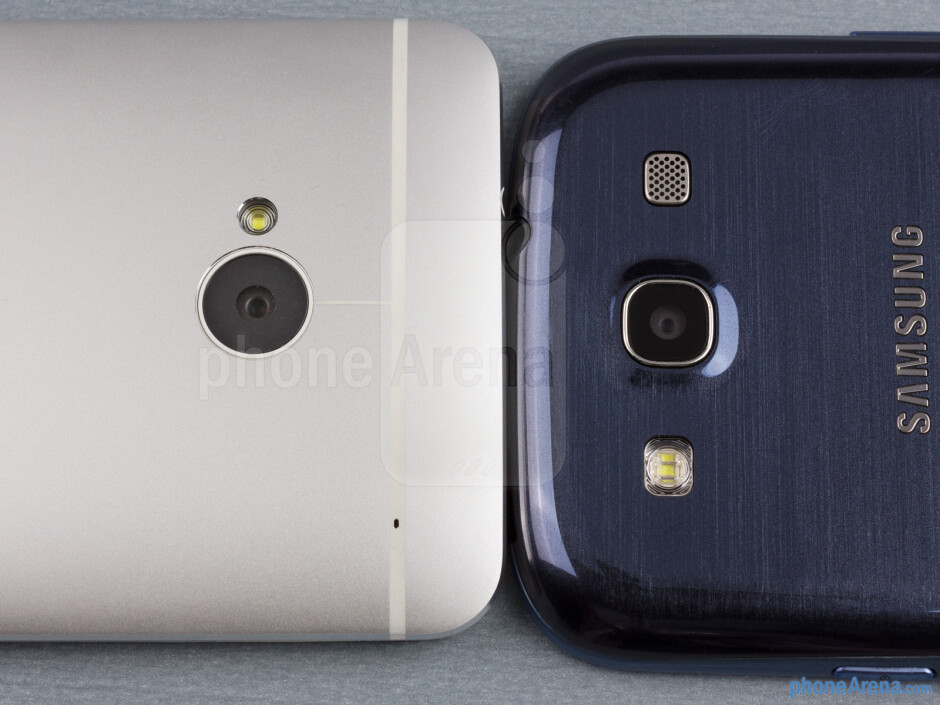 Rear cameras - The sides of the HTC One (bottom, left) and the Samsung Galaxy S III (top, right) - HTC One vs Samsung Galaxy S III