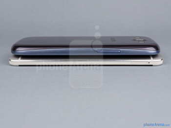 Left sides - The sides of the HTC One (bottom, left) and the Samsung Galaxy S III (top, right) - HTC One vs Samsung Galaxy S III