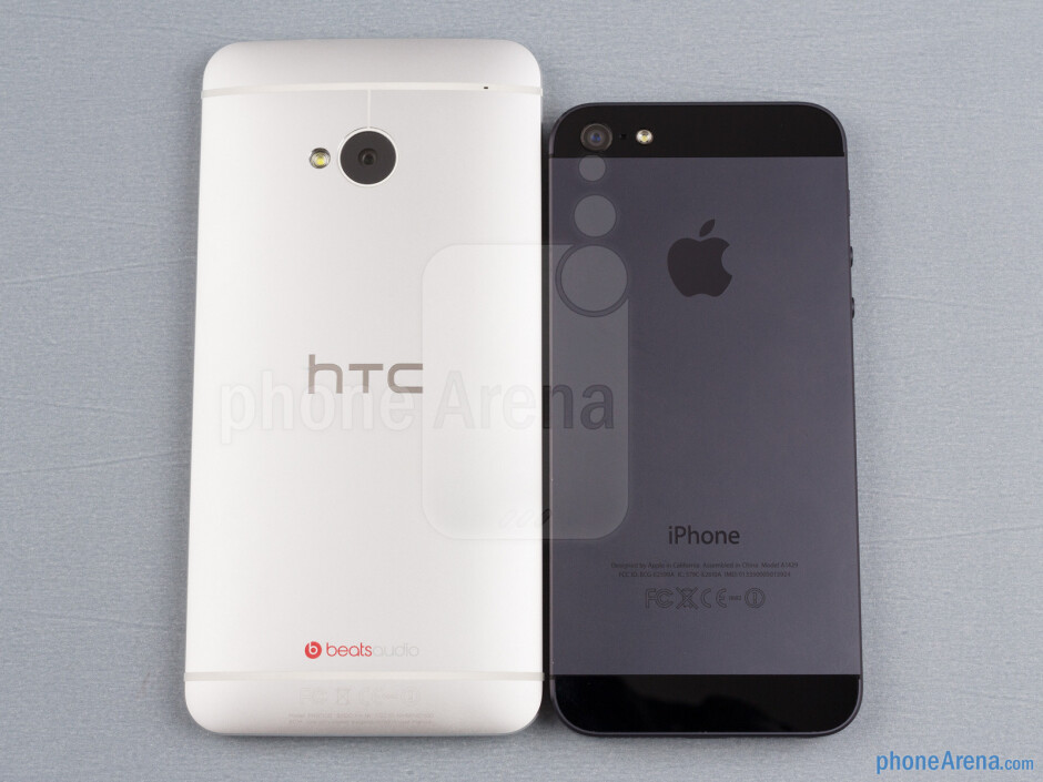 Backs - The sides of the HTC One (bottom, left) and the Apple iPhone 5 (top, right) - HTC One vs Apple iPhone 5