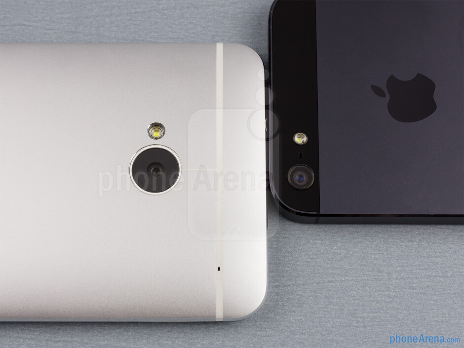 Rear cameras - The sides of the HTC One (bottom, left) and the Apple iPhone 5 (top, right) - HTC One vs Apple iPhone 5