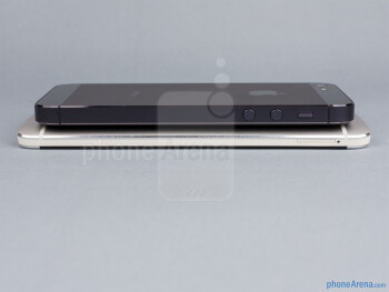 Left sides - The sides of the HTC One (bottom, left) and the Apple iPhone 5 (top, right) - HTC One vs Apple iPhone 5