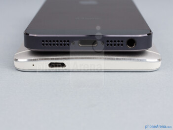 Bottom - The sides of the HTC One (bottom, left) and the Apple iPhone 5 (top, right) - HTC One vs Apple iPhone 5