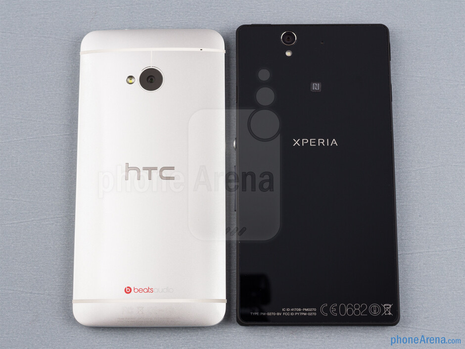 Backs - The sides of the HTC One (down, left) and the Sony Xperia Z (top, right) - HTC One vs Sony Xperia Z