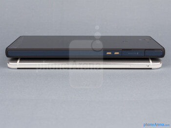 Left sides - The sides of the HTC One (down, left) and the Sony Xperia Z (top, right) - HTC One vs Sony Xperia Z
