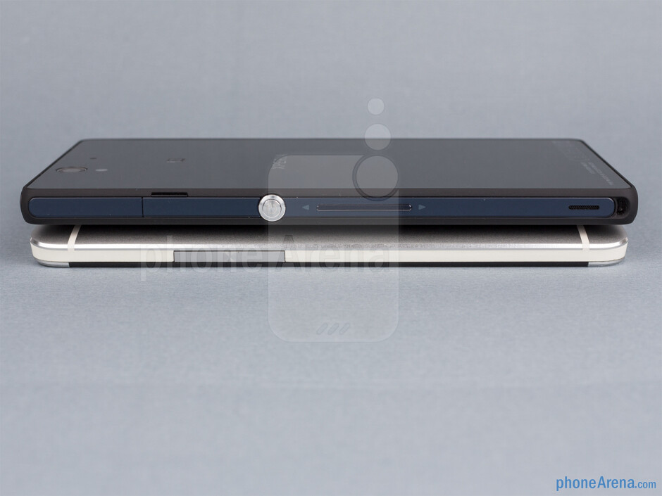 Right - The sides of the HTC One (down, left) and the Sony Xperia Z (top, right) - HTC One vs Sony Xperia Z