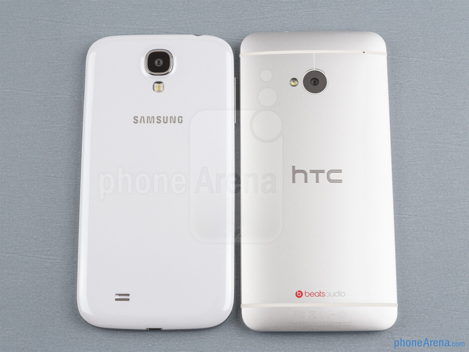 Backs - The Samsung Galaxy S4 (bottom, left) and the HTC One (top, right) - Samsung Galaxy S4 vs HTC One