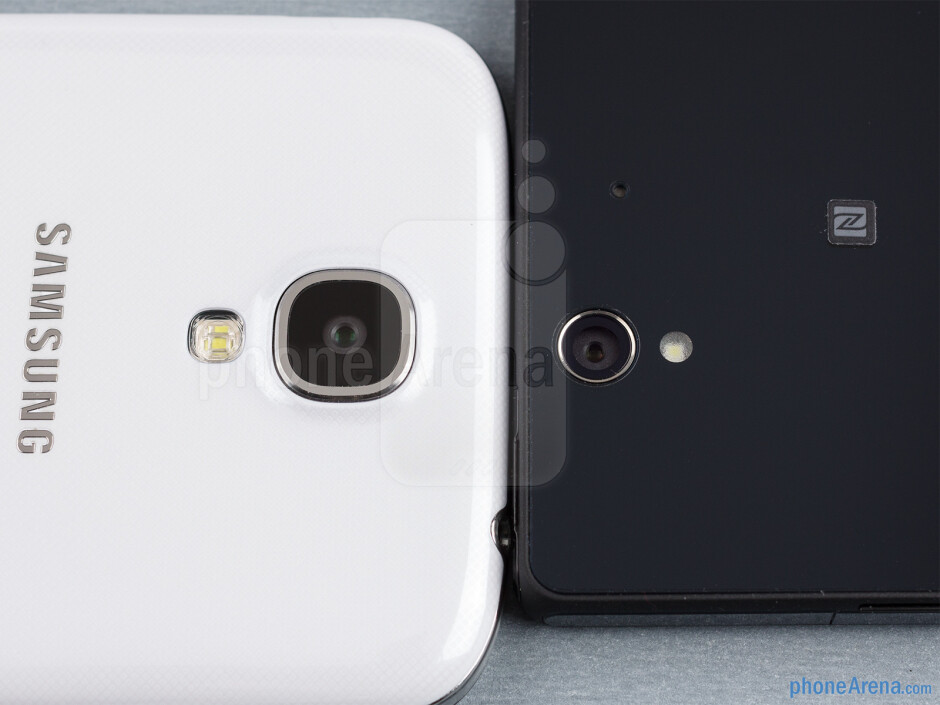 Rear cameras - The sides of the Samsung Galaxy S4 (bottom, left) and the Sony Xperia Z (top, right) - Samsung Galaxy S4 vs Sony Xperia Z