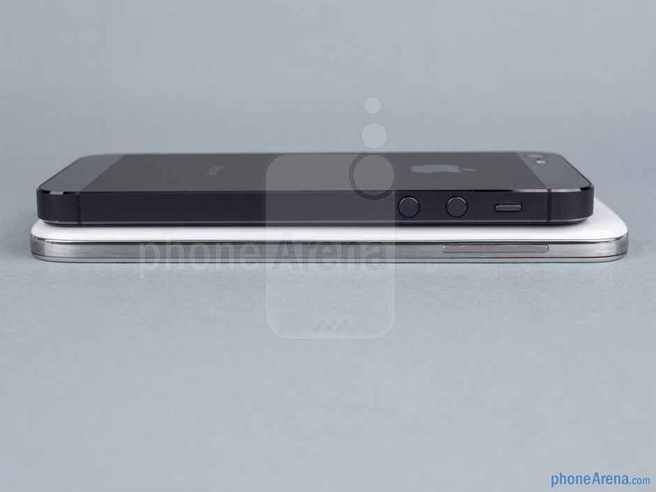 Left sides - The sides of the Samsung Galaxy S4 (bottom, left) and the Apple iPhone 5 (top, right) - Samsung Galaxy S4 vs Apple iPhone 5