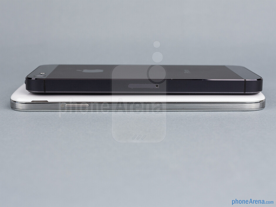 Right - The sides of the Samsung Galaxy S4 (bottom, left) and the Apple iPhone 5 (top, right) - Samsung Galaxy S4 vs Apple iPhone 5