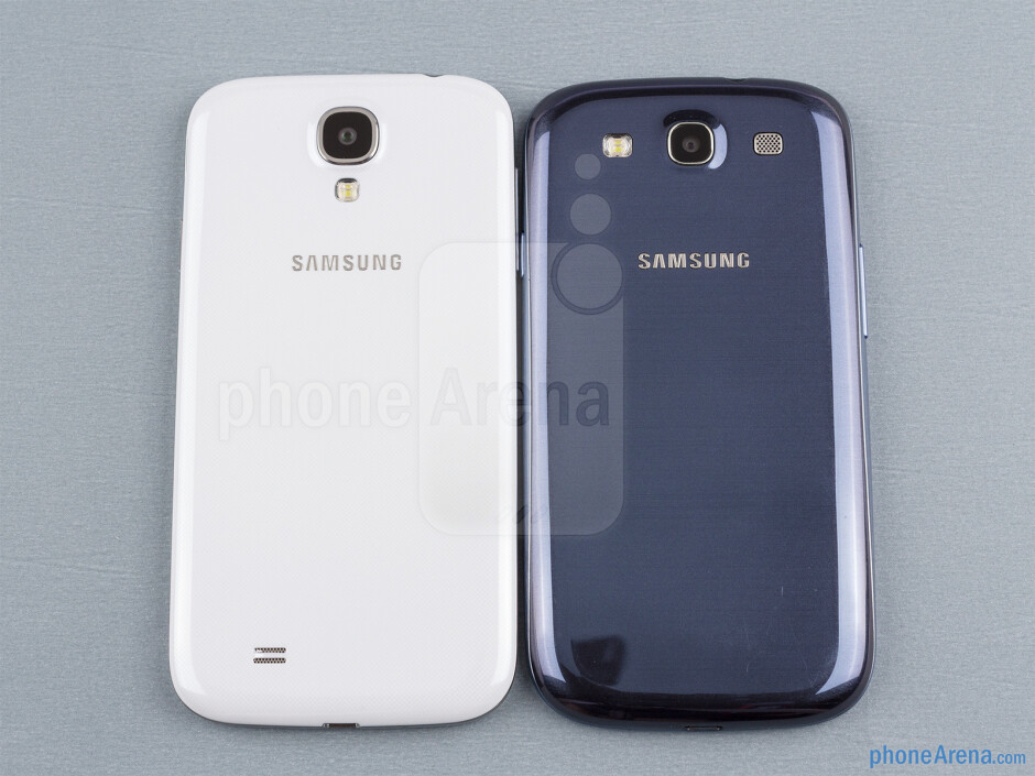 Backs - The sides of the Samsung Galaxy S4 (bottom, left) and the Samsung Galaxy S III (top, right) - Samsung Galaxy S4 vs Samsung Galaxy S III