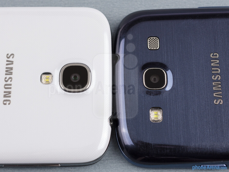 Rear cameras - The sides of the Samsung Galaxy S4 (bottom, left) and the Samsung Galaxy S III (top, right) - Samsung Galaxy S4 vs Samsung Galaxy S III